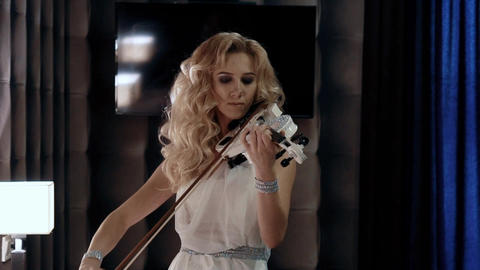 Slow Motion Close-Up Of A Woman Playing The Violin Footage