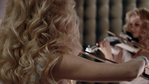 Slow Motion Woman Looks in The Mirror And Playing Violin Footage