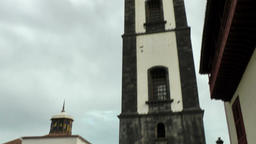 Spain The Canary Islands Tenerife Santa Cruz tower and yard of old church Footage