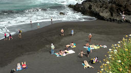 Spain The Canary Islands Tenerife volcanic black sands beach with breakwater Footage