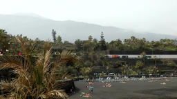 Spain The Canary Islands Tenerife black beach, foggy background with volcano Footage
