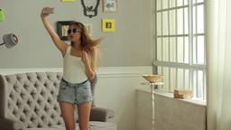 Beautiful girl makes selfie. Sexy girl Footage