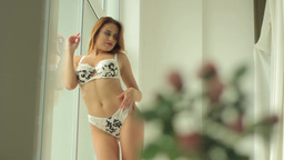 Girl in erotic lingerie seductive moves. Sexy girl Footage