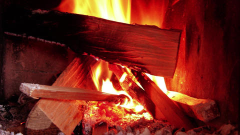 Cuts of wood burning in the stove 20 Footage