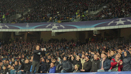 Football fans watching the match in the stands. People, crowd, football fans Footage