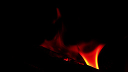 Flame in a fireplace with a dark background 23 Footage