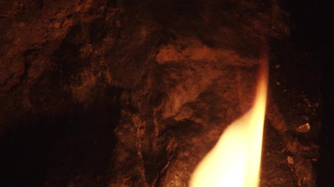 Light a torch in a cave or grotto Enigmatic mysterious 2 Footage