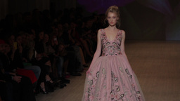 Girl model in dress comes down the runway during the fashion show Footage