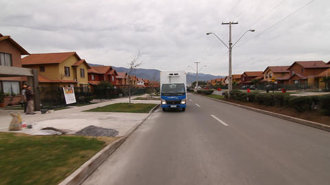 Truck driving in residential area Footage