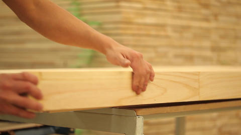 Handling timber product Live Action