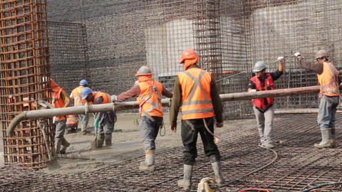 Construction workers pour concrete Footage