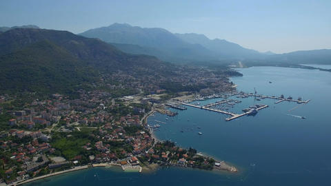 Flying high above Montenegro suburb coast line with buildings and cottages Footage