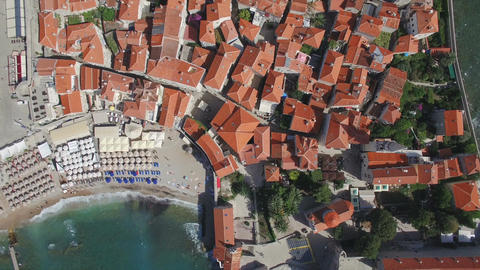 Top view aerial footage of Budva Montenegro old town. Take off and lift with cam Footage