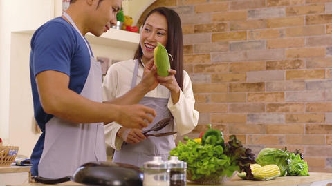 Young Asian Couple in the Kitchen 画像