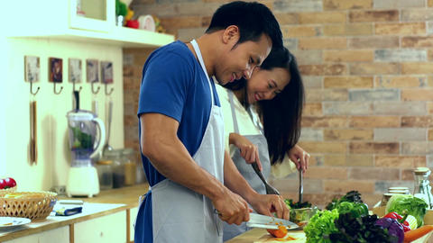 Young Asian Couple in the Kitchen Footage