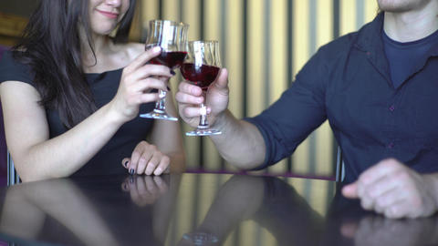 4K Couple In A Restaurant Clinks Glasses With Vine Footage