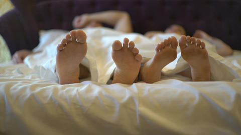 4K Couple In Bed Close- Up Of Feet Footage