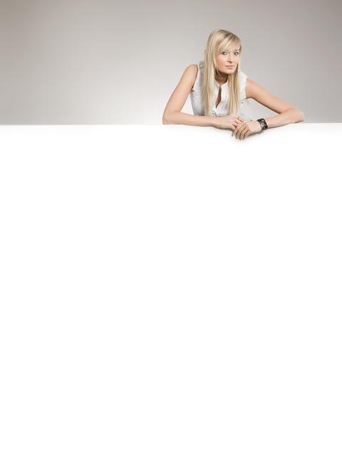 Pretty woman leaning on the white board Fotografía