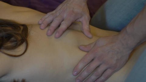 Relaxation Massage For Back. Man Rmassaging For Young Female Footage