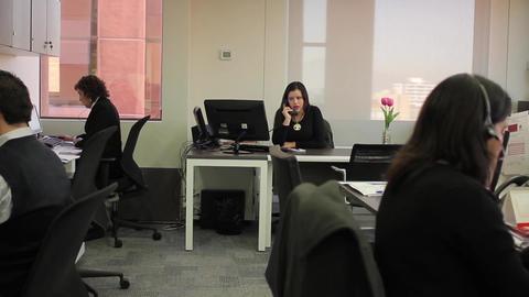 Speaking on office phone Footage