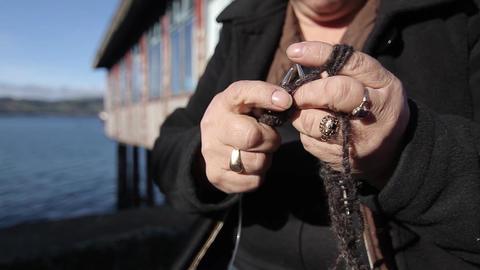 Hands weaving by sea Footage