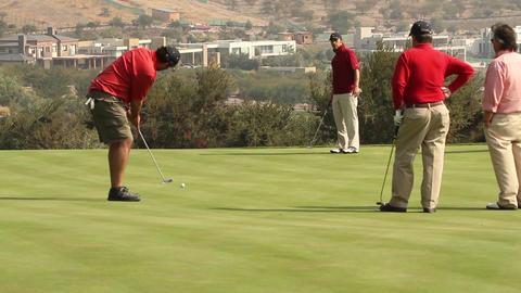 Men playing golf Footage