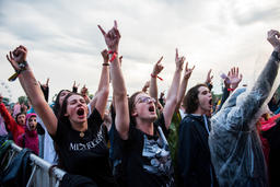 Headbanging crowd in the first row at a hardcore concert Photo