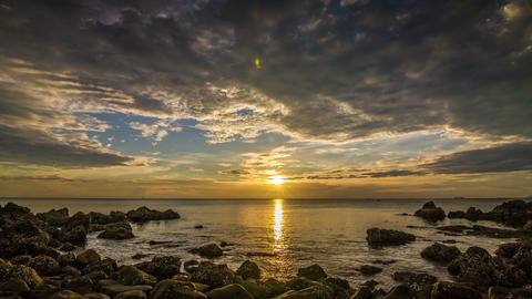 Sunset on sea in rocks bay time lapse Footage