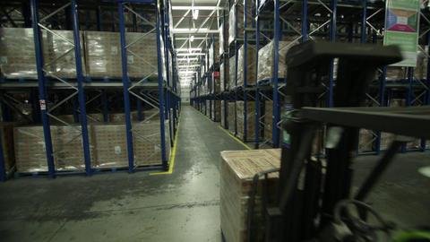 Forklift transports boxes Live Action