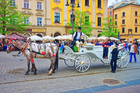 Horse fiacre and people in Old town of Krakow 相片
