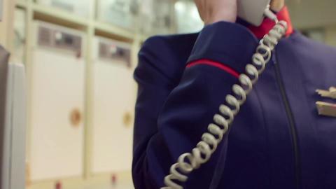 Stewardess talks on intercom Footage