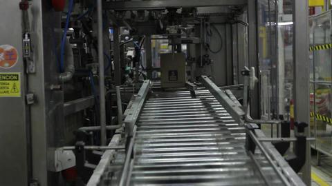 Box on conveyer belt Live Action