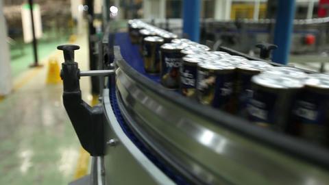 Beer cans on conveyor belt Footage