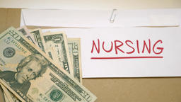 NURSING costs concept Footage