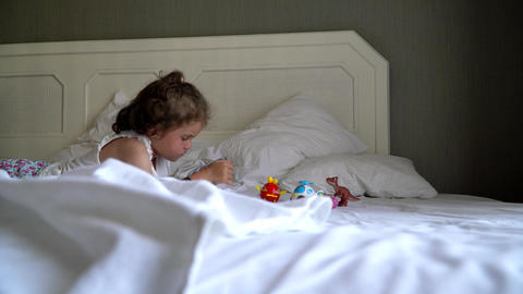 little girl playing on the bed Footage