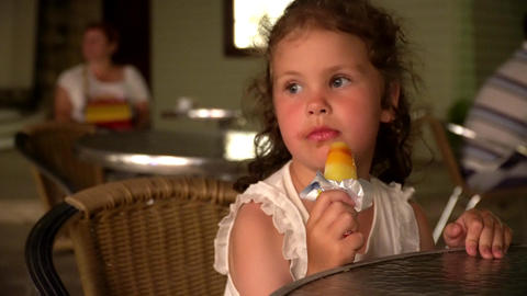 little girl eating ice cream in cafe Footage