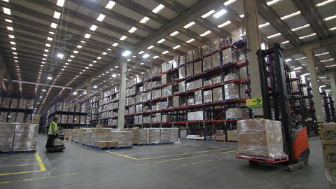 Forklift in storage warehouse Live Action