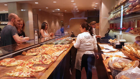 Sellers Selling Pizza to Customers in Venice Footage