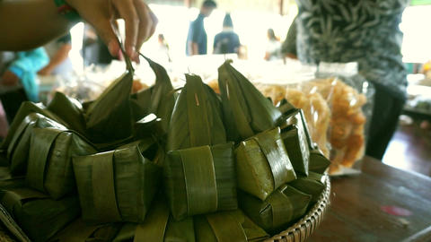 Traditional thai dessert wrapped in banana leaves ビデオ