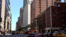 USA New York City Manhattan Hell's Kitchen view of 8th Avenue at 50th Street Footage