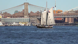 USA New York City Brooklyn Bridge and old sailing ship on East River Footage