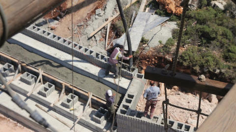 High angle view of construction workers pouring concrete in construction site Footage