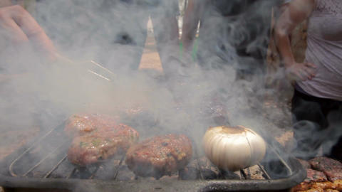 Barbecue beef kebabs cooking on hot grill 画像