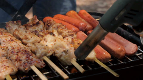 Barbecue shashlik and hotdog cooking on hot grill Footage