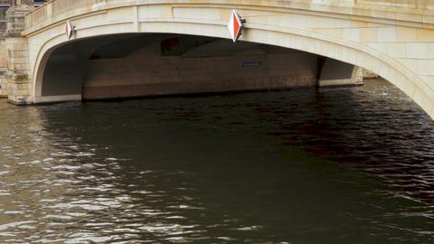 White ship passing under the Friedrichsbrucke bridge on Spree river in rainy day Image
