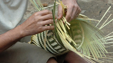 Man weaving bamboo basket Footage