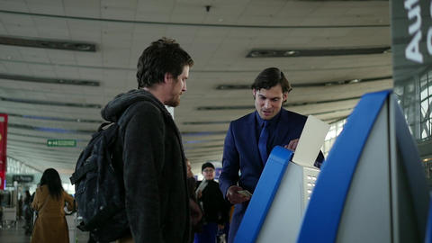 Airport employee helps customer Footage
