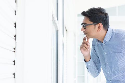 Man looking through the window Photo