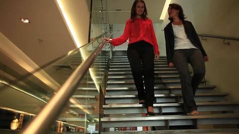 Women descending stairs Footage