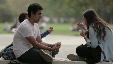 Eating lunch on campus bench Footage